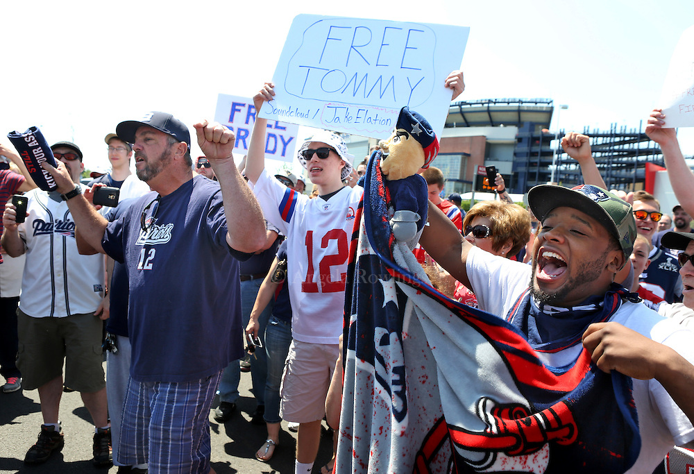 """(Foxboro, MA - 5/24/15) Brian Gourgue[cq] of Boston, right, joins a couple hundred Patriots fans for a """"Free Tom Brady"""" rally at Gillette Stadium, Sunday, May 24, 2015. Staff photo by Angela Rowlings."""