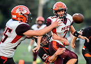 Canistota/Freeman's Trey Ortman (3) pitches the ball to Canistota/Freeman's Austin Thu (25) as Howard's EJ Leetch (52) wraps up Ortman on the play during a nine-man game on Friday night in Howard. (Matt Gade / Republic)