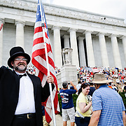 "Conservative television commentator Glenn Beck's ""Restore Honor"" conservative rally at the Lincoln Memorial on the National Mall, held on the 47th anniversary of Dr. Martin Luther King's famous ""I Have a Dream"" civil rights speach of 1963. Speakers from the stage erected on the lower steps of the Lincoln Memorial included Beck himself along with former vice presidential candidate Sarah Palin."