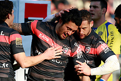 Luke McAlister and Luke Burgess congratulate Yann David after he scores the first try for Toulouse.  Stade Toulousain v ASM Clermont Auvergne, Top 14, Stade Municipal, Toulouse, France, 1st December 2012.
