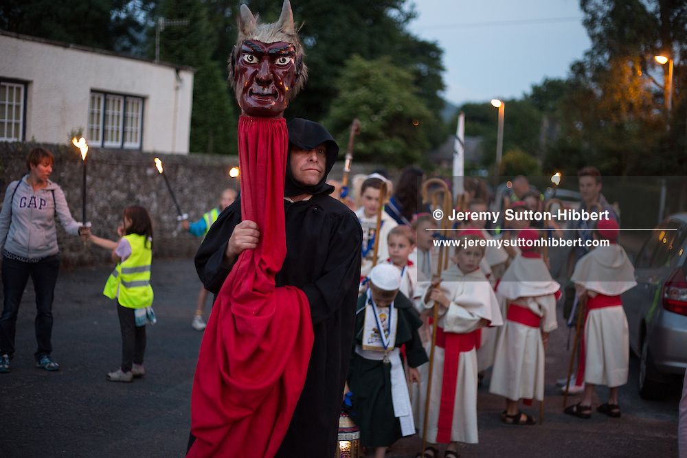 Parade and Burning the De'il (Devil) at the top of Caerlee Hill,, at St. Ronan's Games, in Innerleithen, in the Borders, Scotland, Saturday 20th July 2013. Standard Bearer Lyle Caine, St Ronan Dux Boy Kieran Frost, Dux Girl Emily McNeill.