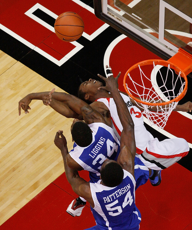 Kentucky's  DeAndre Liggins and Patrick Patterson (54) foul Georgia's Terrance Woodbury during a layup attempt on Sunday, Jan. 18, 2009 at Stegeman Coliseum in Athens, Ga.  The Bulldogs lost the game 68-45 in the fifth game of an 11 game losing streak.