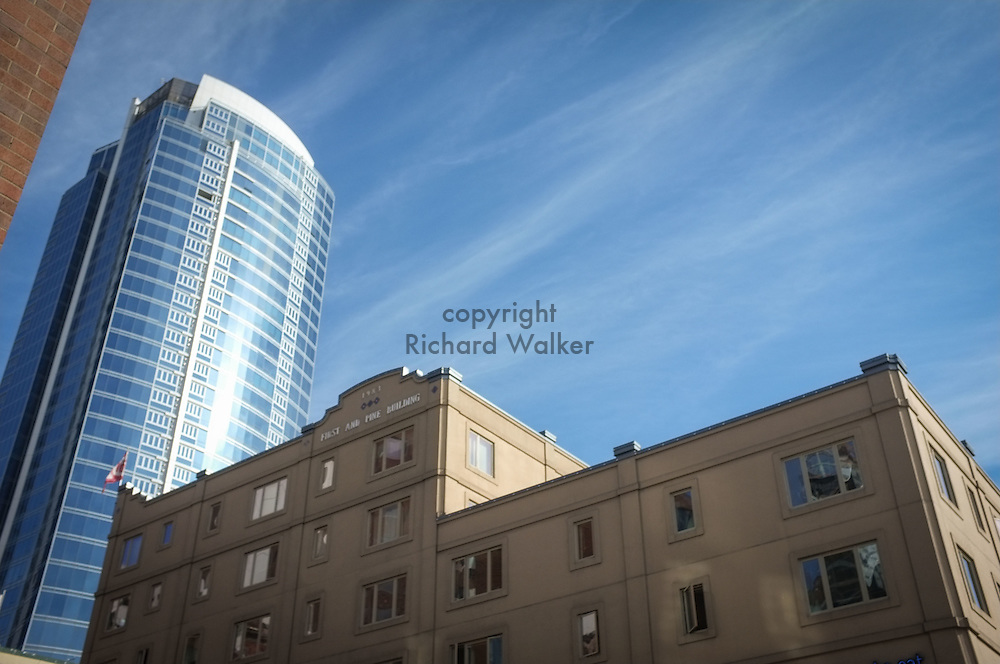 2016 October 22 - First and Pine Building, with 1521 Second Avenue building behind against a blue sky in downtown Seattle, WA, USA. By Richard Walker
