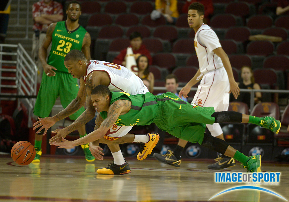 Feb 11, 2015; Los Angeles, CA, USA; Southern California Trojans forward Darion Clark (0) battles for the ball with  Oregon Ducks guard Joseph Young (3) at Galen Center. Oregon defeated USC 80-75.