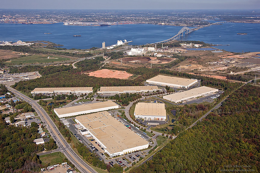Aerial View of Warehouses at Industrial Park with Key Bridge