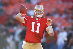 October 10, 2010; San Francisco, CA, USA;  San Francisco 49ers quarterback Alex Smith (11) throws a pass during warm ups before the game against the Philadelphia Eagles at Candlestick Park.