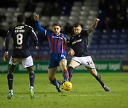 30th January 2018, Tulloch Caledonian Stadium, Inverness, Scotland; Scottish Cup 4th round replay, Inverness Caledonian Thistle versus Dundee; Dundee's Kerr Waddell battles for the ball with Inverness Caledonian Thistle's George Oakley