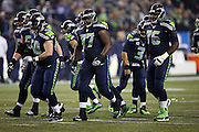 The Seattle Seahawks offense breaks from the huddle and heads toward the line of scrimmage during the NFL week 19 NFC Divisional Playoff football game against the Carolina Panthers on Saturday, Jan. 10, 2015 in Seattle. The Seahawks won the game 31-17. ©Paul Anthony Spinelli