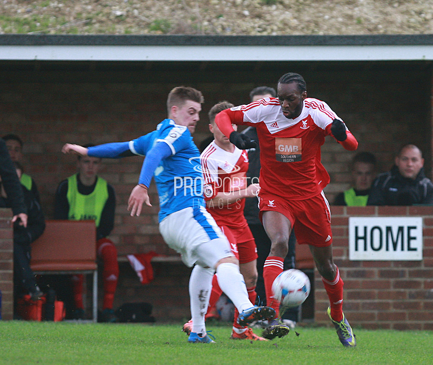 Whitehawk midfielder Arnaud Mendy gets the better of Dover defender Sam Magri during the FA Trophy match between Whitehawk FC and Dover Athletic at the Enclosed Ground, Whitehawk, United Kingdom on 12 December 2015. Photo by Bennett Dean.