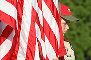 Aaron Wilson, of scout troop 65, West Middlesex, holds onto an American flag at the Sharon Elks' Lodge 103 Flag Day ceremony at Hillcrest Memorial Park.