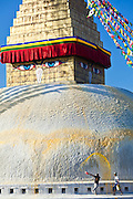 Custodians trhowing colored water over the famed Bodhanth stupa in Kathmandu, Nepal.