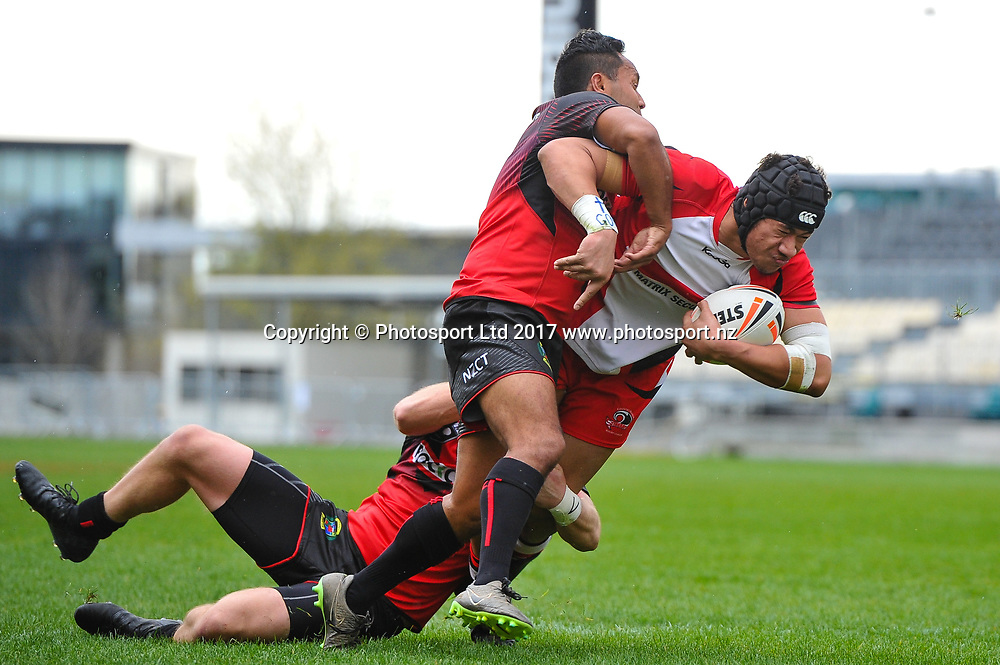 David Faaeteete of the Counties Manukau Stingrays is tackled by Tama Walker and Blake Thompson of the Canterbury Bulls during the NZRL Premiership, Round1 Rugby League match, Cnaterbury Bulls V Counties Manukau Stingrays, AMI Stadium, Christchurch, New Zealand, 17th September 2017. Copyright photo: John Davidson / www.photosport.nz