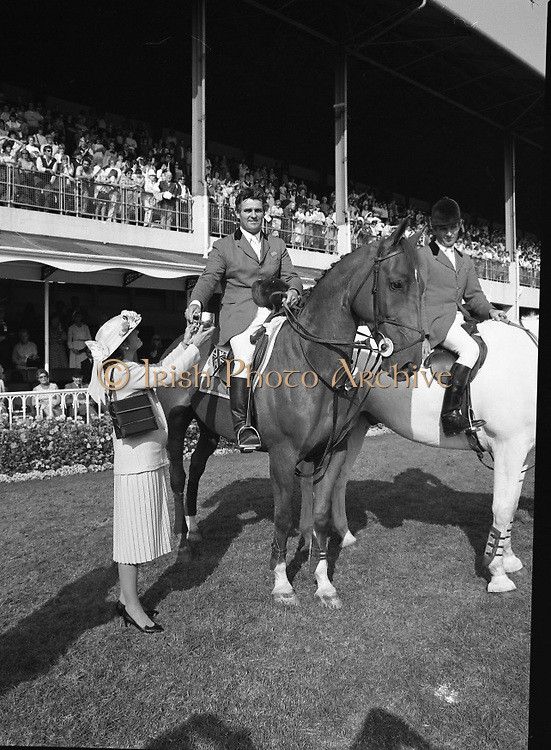 The Dublin Horse Show.1982.07.08.1982.08.07.1982.7th August 1982...The Dublin Horse Show..R.D.S., Ballsbridge, Dublin.The winners of the Aga Khan team trophy were Great Britain. The shows' leading rider was Mr Harvey Smith, Great Britain. .in picture Mr Harvey Smith accepts his team award from Mrs Hely Hutchinson.