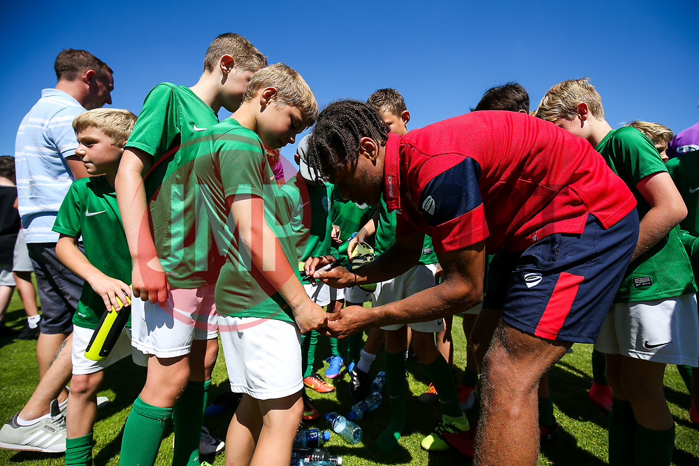 Bobby Reid of Bristol City signs autographs for the Guernsey Mascots - Rogan/JMP - 08/07/2017 - Footes Lane - Guernsey - Guernsey FC v Bristol City - Pre-season Friendly.