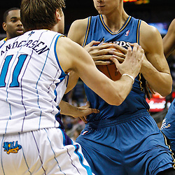 February 1, 2011; New Orleans, LA, USA; Washington Wizards power forward Yi Jianlian (31) controls the ball as New Orleans Hornets center David Andersen (11) defends during the fourth quarter at the New Orleans Arena.   Mandatory Credit: Derick E. Hingle