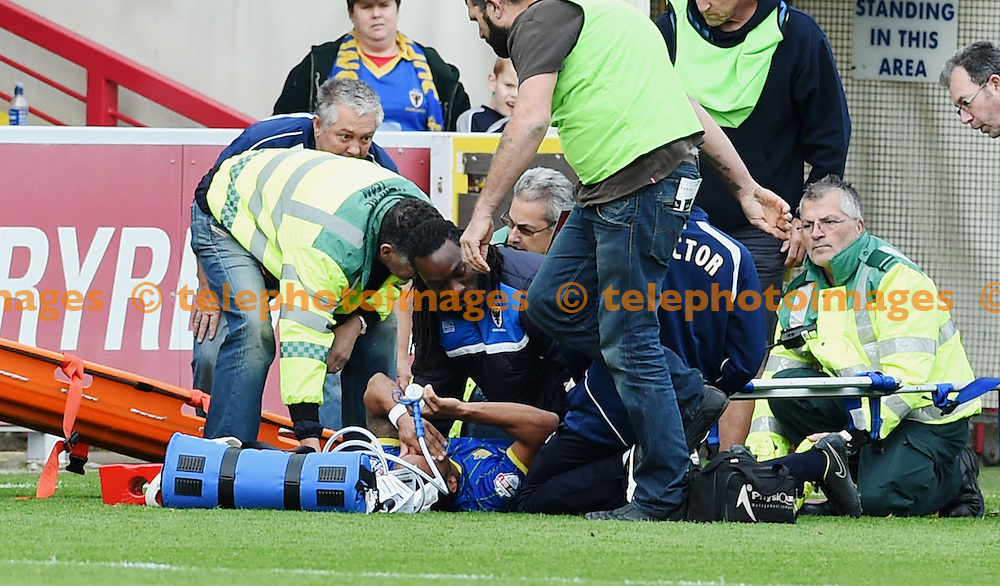 Andy Barcham of Wimbledon needs a stretcher after going down injured in the first half during the Sky Bet League 2 match between AFC Wimbledon and Morecambe at the Cherry Red Records Stadium in Kingston. October 17, 2015.<br /> Simon  Dack / Telephoto Images<br /> +44 7967 642437