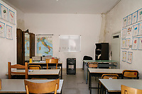 "SUTERA, ITALY - 8 JANUARY 2018: A room in a private home used to teach Italian to adult asylum seekers is seen here in Sutera, Italy, on January 8th 2018.<br /> <br /> Sutera is an ancient town plastered onto the side of an enormous monolithic rock, topped with a convent, in the middle of the western half of Sicily, about 90 minutes by car south of the Sicilian capital Palermo<br /> Its population fell from 5,000 in 1970 to 1,500 today. In the past 3 years its population has surged  after the local mayor agreed to take in some of the thousands of migrants that have made the dangerous journey from Africa to the Sicily.<br /> <br /> ""Sutera was disappearing,"" says mayor Giuseppe Grizzanti. ""Italians, bound for Germany or England, packed up and left their homes empty. The deaths of inhabitants greatly outnumbered births. Now, thanks to the refugees, we have a chance to revive the city.""<br />  Through an Italian state-funded project called SPRAR (Protection System for Refugees and Asylum Seekers), which in turn is co-funded by the European Union's Fund for the Integration of non-EU Immigrants, Sutera was given financial and resettlement assistance that was co-ordinated by a local non-profit organization called Girasoli (Sunflowers). Girasoli organizes everything from housing and medical care to Italian lessons and psychological counselling for the new settlers.<br /> The school appears to have been the biggest beneficiary of the refugees' arrival, which was kept open thanks to the migrants.<br /> Nunzio Vittarello, the coordinator of the E.U. project working for the NGO ""I Girasoli"" says that there are 50 families in Sutera at the moment."