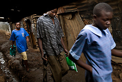 People walk the trash filled streets in Mathare, one of the poorest slums in Nairobi.  Running water and electricity are scarce and trash and human waste fills the streets.  Many people have no jobs and those who do work can earn less than one dollar a day.