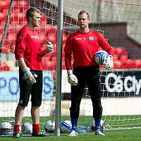St Johnstone Training....24.08.12<br /> Alan Mannus talks with fellow keeper Zander Clark<br /> Picture by Graeme Hart.<br /> Copyright Perthshire Picture Agency<br /> Tel: 01738 623350  Mobile: 07990 594431