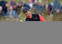 Photo: Daniel Hambury.<br /> WGC American Express Championship, The Grove. 01/10/2006.<br /> Tiger Woods chips out of the bunker onto the 12th green.