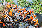 JIUJIANG, CHINA - JULY 12: <br /> <br /> Armed police officers and soldiers standing in the flood to prevent the water at a four-meter-long gap in the river on July 12, 2016 in Jiujiang, Jiangxi Province of China. Armed police officers and soldiers jumped into the flood and combined bodies to prevent the water washing through the four-meter-long gap into the rice fields near the Poyang Lake in Jiujiang on Tuesday. Officers and soldiers had been in the water for over six hours and the piles and sand bags were consolidated in the gap. <br /> ©Exclusivepix Media