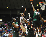 Mississippi's Murphy Holloway (31) scores over Mississippi Valley State's Montrell Holley (42), Blake Ralling (22), and Davon Usher (0) in Oxford, Miss. on Friday, November 9, 2012.