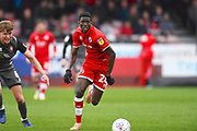 Crawley Town player Panutche Camara moves the ball down field in the first half during the EFL Sky Bet League 2 match between Crawley Town and Lincoln City at The People's Pension Stadium, Crawley, England on 23 March 2019.