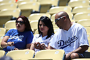 LOS ANGELES, CA - JULY 13:  Fans hang out at their seats before the Los Angeles Dodgers game against the San Diego Padres at Dodger Stadium on Sunday, July 13, 2014 in Los Angeles, California. The Dodgers won the game 1-0. (Photo by Paul Spinelli/MLB Photos via Getty Images)