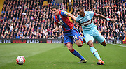 Martin Kelly and Diarfra Sakho battle for the ball during the Barclays Premier League match between Crystal Palace and West Ham United at Selhurst Park, London, England on 17 October 2015. Photo by Michael Hulf.