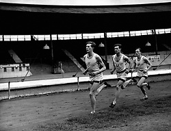 File photo dated 16-03-1948 of Roger Bannister (front) during a training session at the White City will represent Oxford University against Cambridge in the Inter-Varsity mile event at the white City in London.