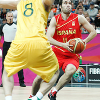31 July 2012: Spain Fernando San Emeterio goes to the basket in the traffic during the 82-70 Spain victory over Australia, during the men's basketball preliminary, at the Basketball Arena, in London, Great Britain.