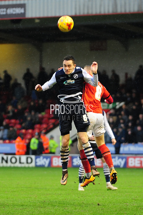 Shaun Williams of Millwall FC and Sam Mantom of Walsall FC battles for a header during the Sky Bet League 1 match between Walsall and Millwall at the Banks's Stadium, Walsall, England on 6 February 2016. Photo by Mike Sheridan.