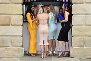 Four girls get to the sangria concession before the crowds prior to  the MacMillan Charity Raceday held at York Racecourse, York, United Kingdom on 15 June 2019.