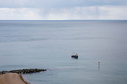 A British fishing boat laying down pots to catch crab and lobsters off the coast of Folkestone in the English Channel. United Kingdom. Ferries and France can be seen on the horizon.  (photo by Andrew Aitchison / In pictures via Getty Images)