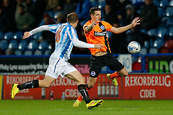 Lewis Dunk of Brighton is challenged by Grant Holt of Huddersfield Town - Photo mandatory by-line: Rogan Thomson/JMP - 07966 386802 - 21/10/2014 - SPORT - FOOTBALL - Huddersfield, England - The John Smith's Stadium - Huddersfield Town v Brighton & Hove Albion - Sky Bet Championship.
