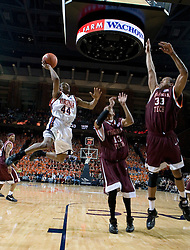 Virginia Cavaliers point guard Sean Singletary (44) shoots over Virginia Tech Hokies forward Deron Washington (13) and Virginia Tech Hokies forward Coleman Collins (33).  The Virginia Cavaliers Men's Basketball Team defeated the Virginia Tech Hokies 69-56 at the John Paul Jones Arena in Charlottesville, VA on March 1, 2007.