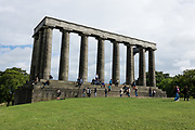 "The National Monument of Scotland, on Calton Hill in Edinburgh, is Scotland's national memorial to the Scottish soldiers and sailors who died fighting in the Napoleonic Wars. Modelled upon the Parthenon in Athens, it was designed in 1823-6 by Charles Robert Cockerell and William Henry Playfair. Construction started in 1826 but due to the lack of funds it was left unfinished in 1829, giving rise to nicknames such as ""Scotland's Disgrace,"" and ""Edinburgh's Folly."" Edinburgh is the capital city of Scotland, in Lothian on the Firth of Forth, Scotland, United Kingdom, Europe."