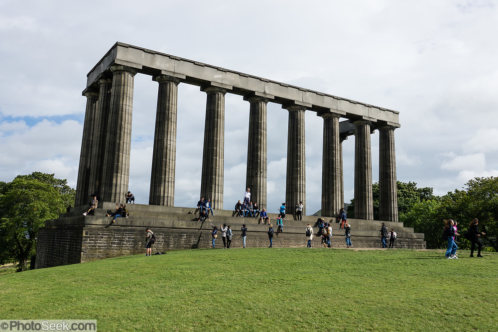 """The National Monument of Scotland, on Calton Hill in Edinburgh, is Scotland's national memorial to the Scottish soldiers and sailors who died fighting in the Napoleonic Wars. Modelled upon the Parthenon in Athens, it was designed in 1823-6 by Charles Robert Cockerell and William Henry Playfair. Construction started in 1826 but due to the lack of funds it was left unfinished in 1829, giving rise to nicknames such as """"Scotland's Disgrace,"""" and """"Edinburgh's Folly."""" Edinburgh is the capital city of Scotland, in Lothian on the Firth of Forth, Scotland, United Kingdom, Europe."""