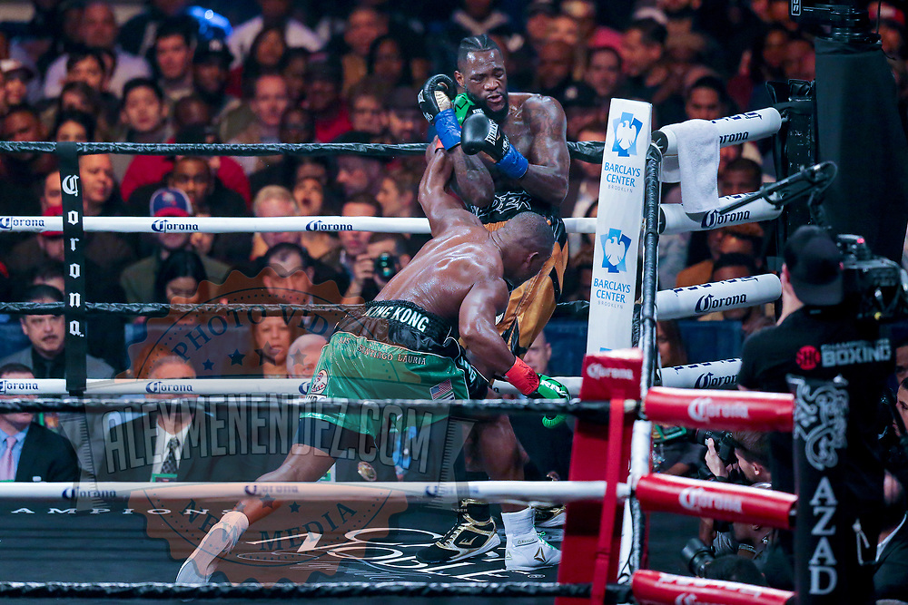 Luis Ortiz lands a shot to the head on Deontay Wilder during the WBC Heavyweight Championship boxing match at Barclays Center on Saturday, March 3, 2018 in Brooklyn, New York. Wilder would win the bout by knockout in the tenth round to retain the title and move to 40-0. (Alex Menendez via AP)