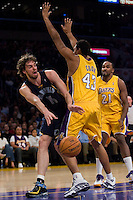 27 March 2007: Center Pau Gasol of the Memphis Grizzlies passes the ball around Brian Cook of the Los Angeles Lakers during the first half of the Grizzlies 88-86 victory over the Lakers at the STAPLES Center in Los Angeles, CA.