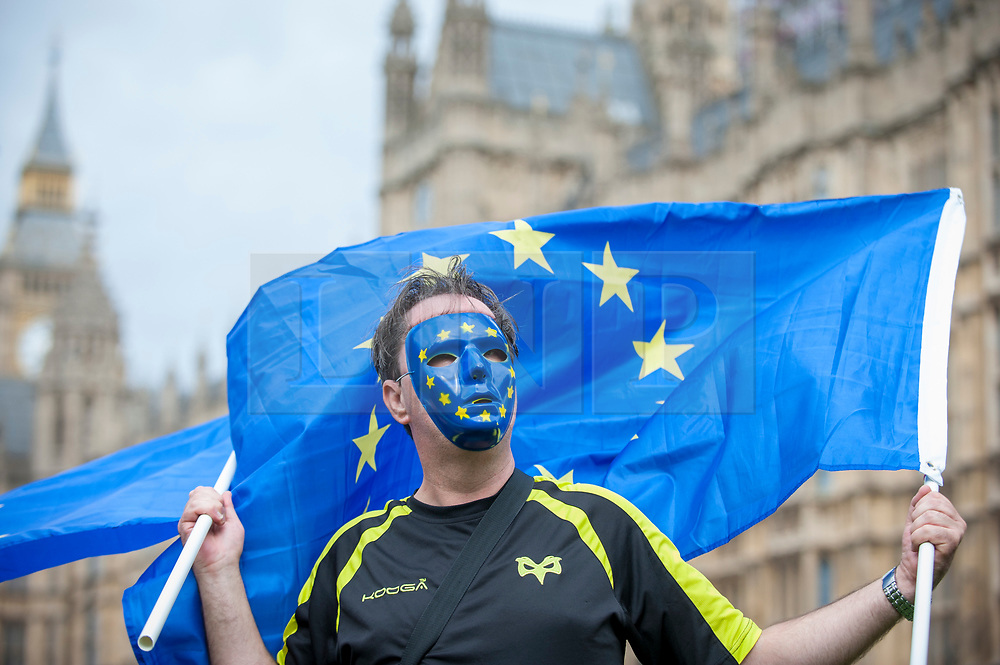 © Licensed to London News Pictures. 07/09/2017. London, UK. An anti-Brexit protester wearing a mask showing the European flag is seen outside the Houses of Parliament  in an attempt to influence MP's decision making on Brexit negotiations.   Photo credit : Stephen Chung/LNP