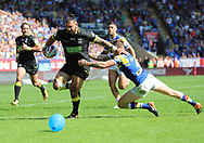 Ben Murdoch-Masila of Warrington Wolves breaks through the tackle of Liam Sutcliffe before scoring the fourth try against Leeds Rhinos during the Ladbrokes Challenge Cup Semi Final match at the Macron Stadium Stadium, Bolton.<br /> Picture by Michael Sedgwick/Focus Images Ltd +44 7900 363072<br /> 05/08/2018