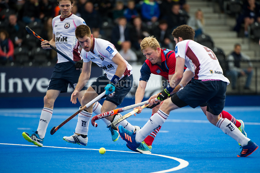 Hampstead & Westminster's Rupert Shipperley is tackled by Peter Friend of Wimbledon as he drives into the circle. Wimbledon v Hampstead & Westminster - Semi-Final - Men's Hockey League Finals, Lee Valley Hockey & Tennis Centre, London, UK on 22 April 2017. Photo: Simon Parker
