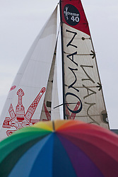 Kiel - Germany, 29th of August 2009. iShares cup. Second day of racing...The crowd is watching the extreme 40's racing close to the shore. Even the rain didn't stop the spectators watching. In the background Oman Sail's Masirah.