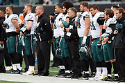Philadelphia Eagles players stand at attention with hands across their chests during the playing of the National Anthem before the 2016 NFL week 13 regular season football game against the Cincinnati Bengals on Sunday, Dec. 4, 2016 in Cincinnati. The Bengals won the game 32-14. (©Paul Anthony Spinelli)