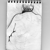 Sketchbook drawing of naked female figure