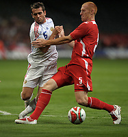 Aleksandr Kerzhakov of Russia and James Collins of Wales <br /> Wales vs Russia<br /> 2010 World Cup Qualifier, Millennium Stadium, Cardiff, UK<br /> 09/09/2009. Credit Colorsport/Dan Rowley<br /> Football