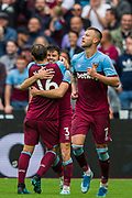 Mark Noble (Capt) (West Ham) congratulating Aaron Cresswell (West Ham) on his goal with Andriy Yarmolenko (West Ham) in the foreground during the Premier League match between West Ham United and Manchester United at the London Stadium, London, England on 22 September 2019.
