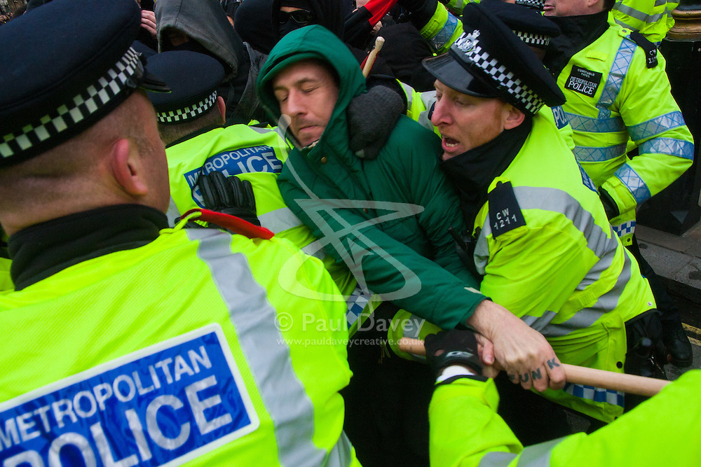 Whitehall, London, April 4th 2015. As PEGIDA UK holds a poorly attended rally on Whitehall, scores of police are called in to contain counter protesters from various London anti-fascist movements. PICTURED: Police battle with anti-fascist counter-protesters as they attempt to confront the small PEGIDA rally.