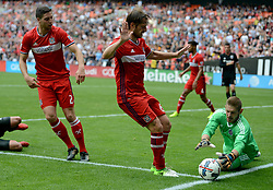 May 20, 2017 - Washington, DC, USA - 20170520 - Chicago Fire goalkeeper MATT LAMPSON (28) dives on the ball as Chicago Fire defender JOAO MEIRA (66) and Chicago Fire midfielder MATT POLSTER (2) look on during the second half against D.C. United at RFK Stadium in Washington. (Credit Image: © Chuck Myers via ZUMA Wire)